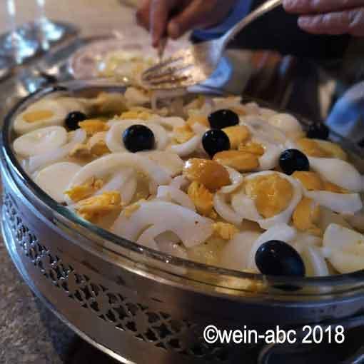 Traditionsgericht: Bacalhau à gomes de Sá ©wein-abc 2018